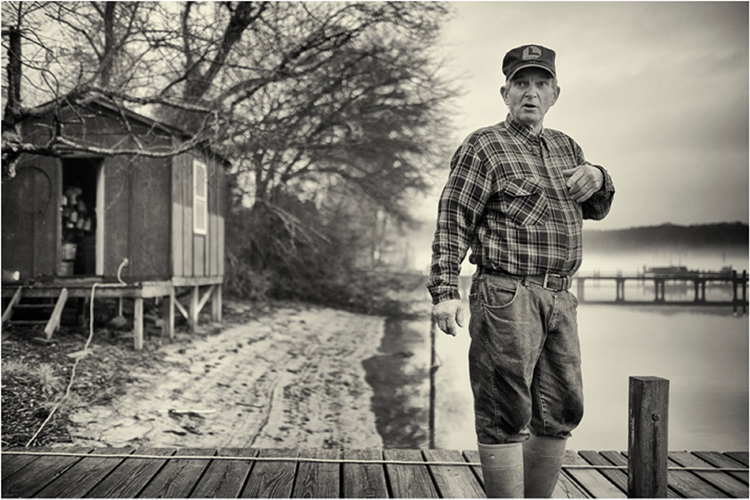 SECOND PLACE: Dennis Newton on the dock Christmas Day, 2015, Archival Pigment Print by Jeromie Stephens (February 2016)