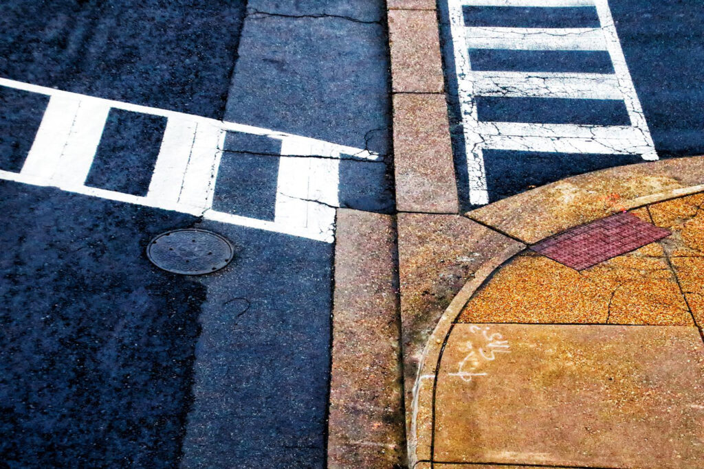 THIRD PLACE: Crosswalk, Photography by Norma Woodward, 12in x 18in, $225 (February 2020)